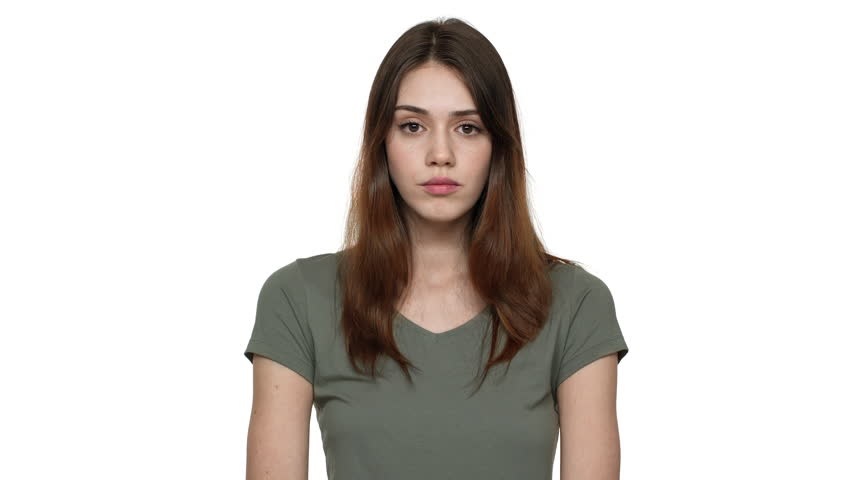 Portrait of european woman 20s rolling her eyes and expressing disinterest or indifference, isolated over white background closeup. Concept of emotions | Shutterstock HD Video #1009269380