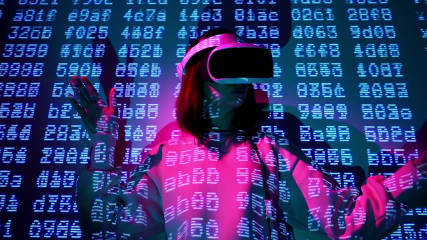 Girl in an interactive VR helmet dances and enjoys virtual reality. Escapes from reality in virtual space. Elctronic barcode wall background