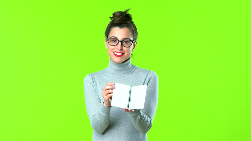 Young pretty woman holding a notebook | Shutterstock HD Video #1009300619