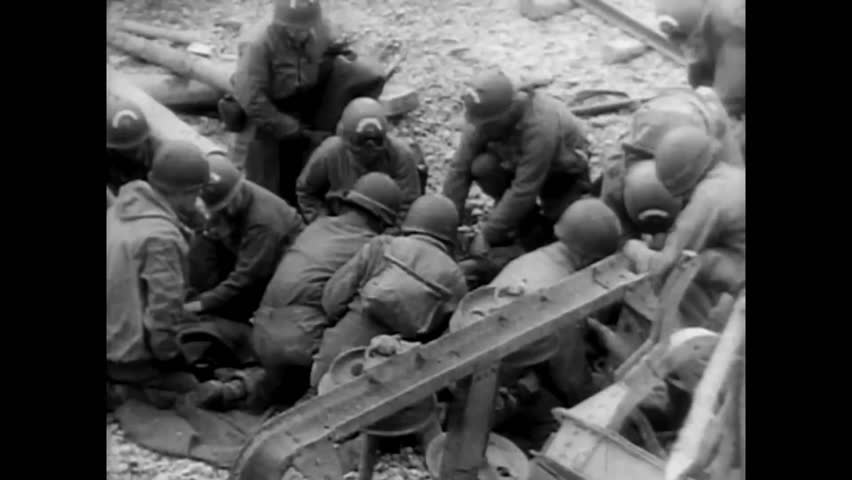 CIRCA 1940 - Post WW11 film explores D-Day, the first landings at Normandy.