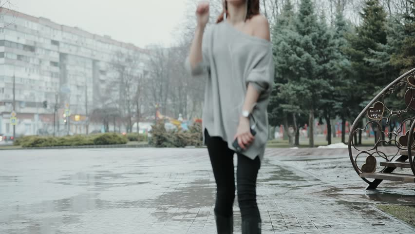 Woman enjoying rainy day with music