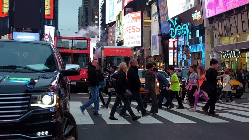 NEW YORK CITY, Circa 2017. Crowded Times Square, the greatest commercial intersection, tourist destination and entertainment center in Manhattan. NY, United States. Slow motion