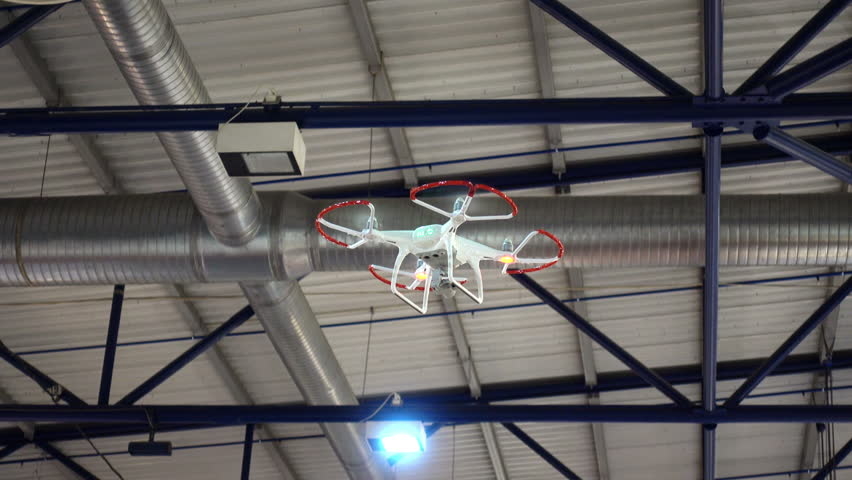 Demonstration flight of a drone or quadrocopter inside the building. HD video   Shutterstock HD Video #1009390277