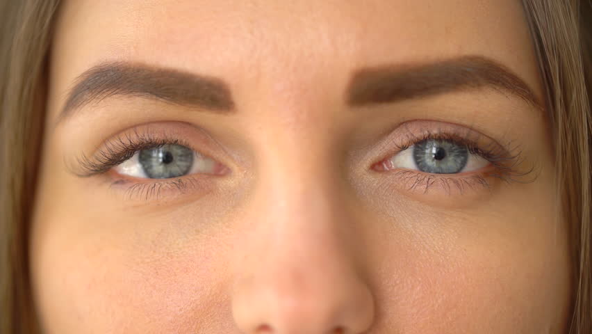 A close up portrait of beauty young beautiful woman's eyes, smiling looking at camera. 4 k. blue eyes of woman face, beautiful woman girl female portrait model, The girl's eye. opening her blue eyes