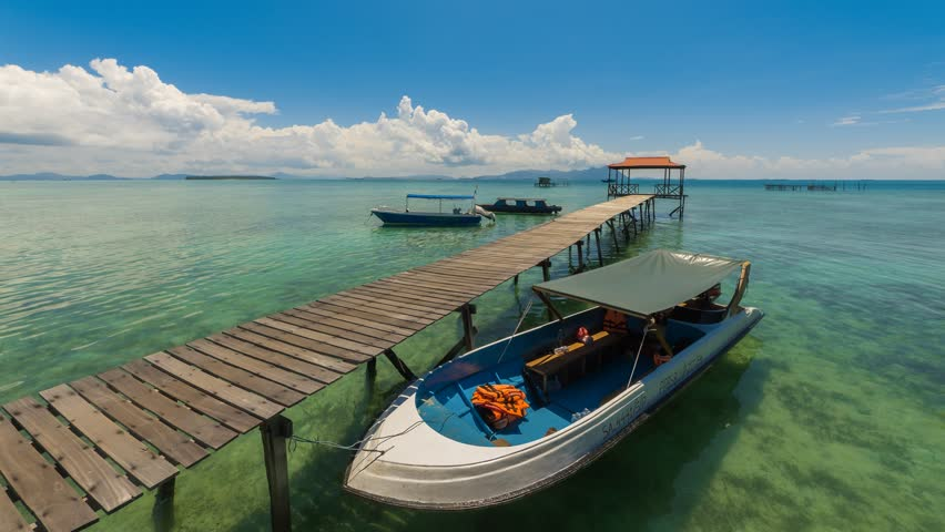 SEMPORNA, SABAH - CIRCA APRIL 2017: Time lapse of day jetty view with dancing clouds and motion blur at Salakan Island, Semporna, Sabah, Malaysia. 4K resolution | Shutterstock HD Video #1009401065