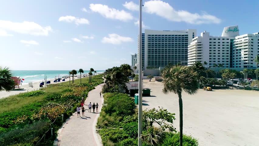 MIAMI, USA - FEB 25, 2018: Sunny day in Miami aerial 4K slow motion   Shutterstock HD Video #1009401191