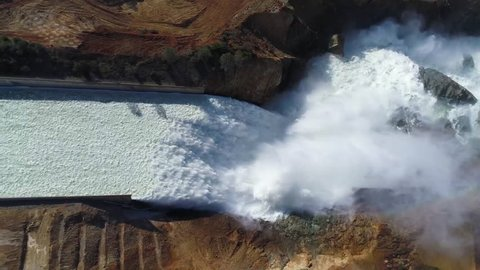 CIRCA 2017 - Spectacular aerial of water flowing through the restored new spillway at Oroville Dam, California.