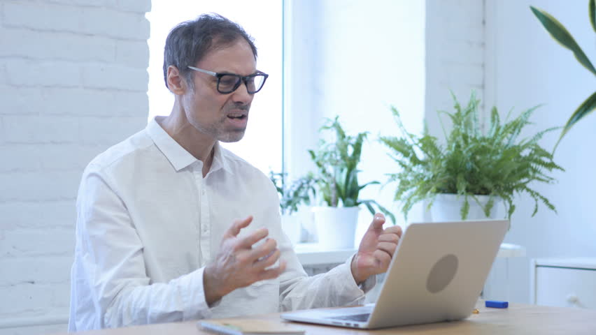 Upset Angry Middle Aged Man Working on Laptop in Office | Shutterstock HD Video #1009437794