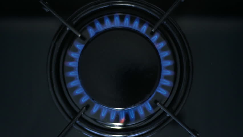 Kitchen burner turning on.Stove top burner igniting into a blue cooking flame.  Natural gas inflammation, close up, slow motion.  | Shutterstock HD Video #1009467296