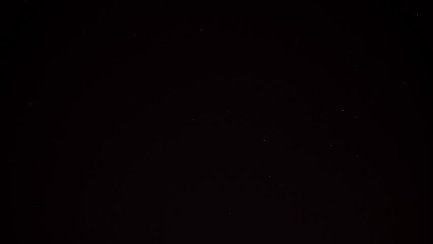 Stars and satellites in the clear dark sky pass slowly. Their lights are clearly visible. Time lapse shot. #1009467488