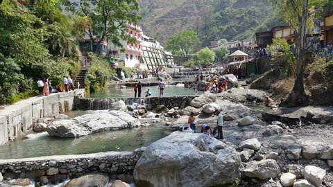 Sahastradhara, India - March 30, 2018: Sahastradhara is one of the most popular tourist destinations of sulphur water spring. Bathing in this sulphur water spring feels cold