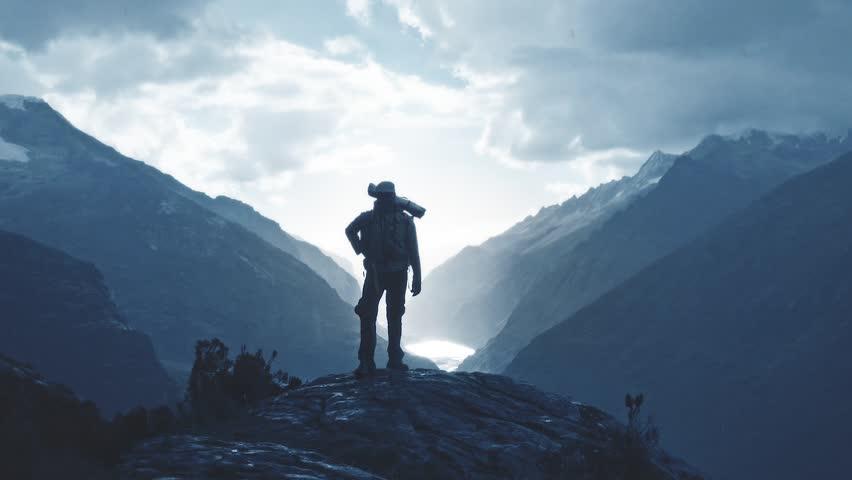 Silhouette of a backpacker walking on the peak of a mountain, Santa cruz Trek, Peru. 4k #1009482248