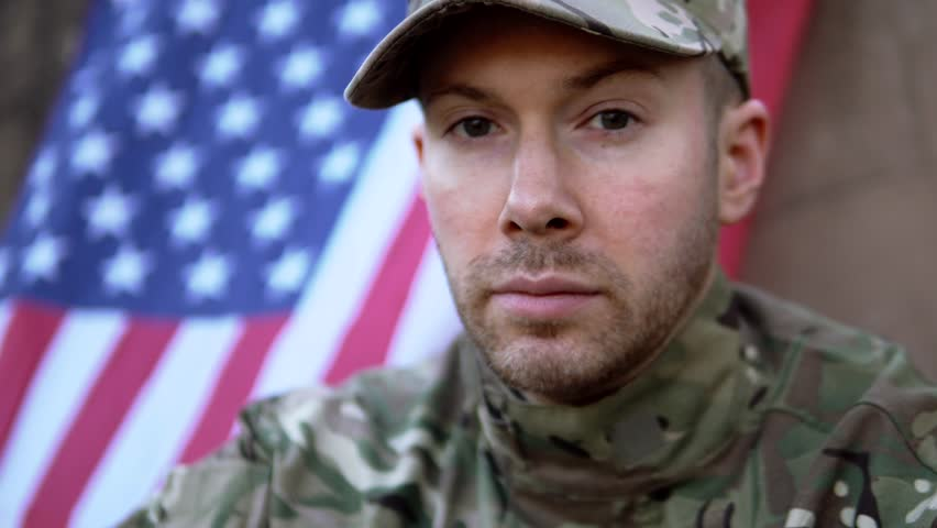 Proud American Soldier Man In Front Of Stars And Stripes Flag. Part Of A 4K Military Collection With A Variety Of Camera Angles And Stories.