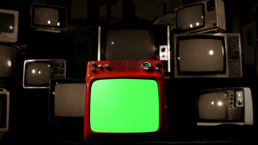 A Red TV with Green Screen in the Foreground over a Retro TV Background. Dolly Out and Dolly In. Sepia Tone.  | Shutterstock HD Video #1009488794