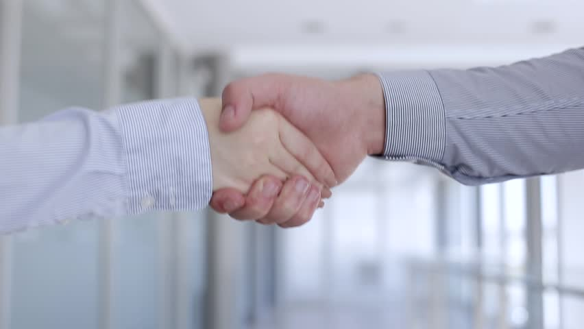 Handshake Business Partners   Shutterstock HD Video #1009512407