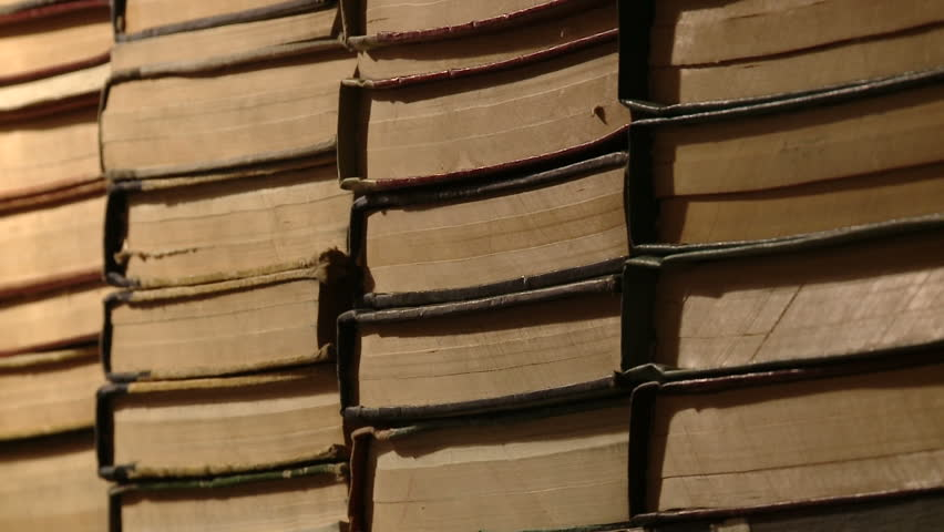 Dolly motion on a shelf of old books