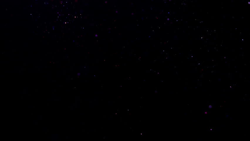 Colorful particles floating in the air in the black background #1009521506