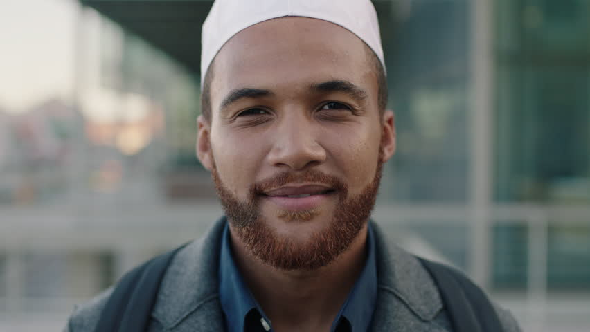 portrait of young muslim business owner close up of businessman standing in city #1009533542