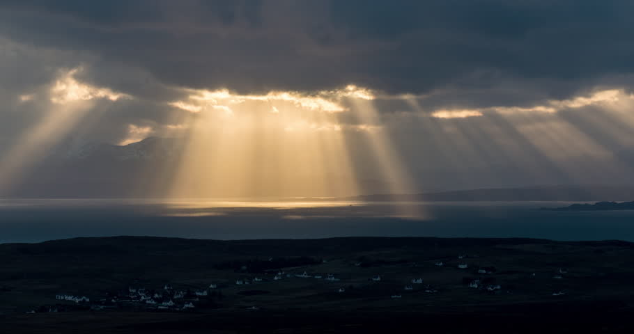 Beautiful rays of sun breaking through the clouds over Isle of Skye, Scotland. | Shutterstock HD Video #1009539329