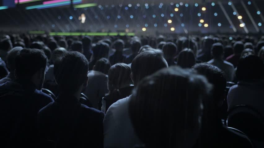 Spectators sit on seats in break of concert #1009542599