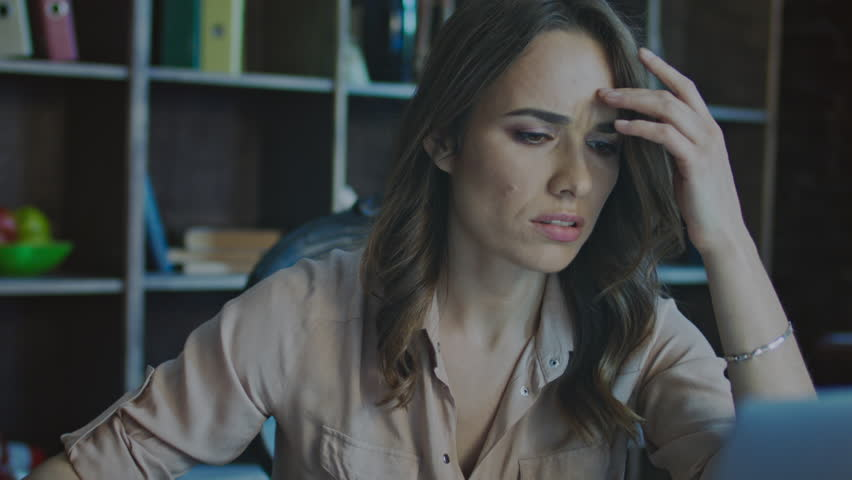 Worried business woman face looking at laptop in office. Close up of upset businesswoman thinking about mistakes in work. Portrait of sad girl looking laptop. Depressed employee working on laptop | Shutterstock HD Video #1009561580