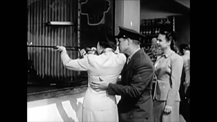 CIRCA 1950 - People run for shelter when an atomic air raid siren goes off.