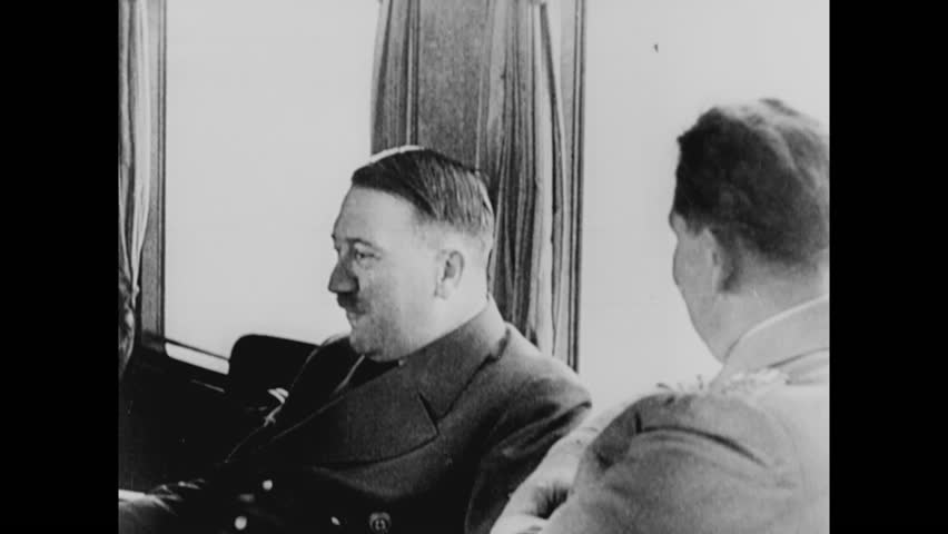 CIRCA 1943 - Adolf Hitler meets with Nazi officials on a train to strategize and, later, he sees a ship off during World War 2.