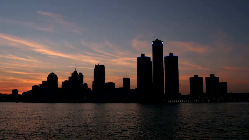 The silhouetted Detroit skyline at sunset