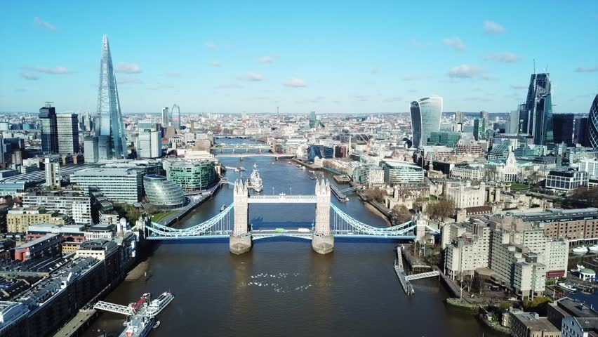 Aerial drone bird's eye view video of iconic Tower Bridge and skyline in City of London, United Kingdom