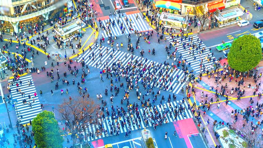 4K. Time lapse pedestrians and traffic across Shibuya Crossing Tokyo, Japan