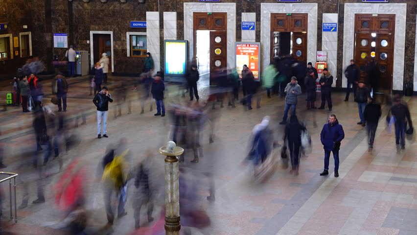KIEV, UKRAINE - MARCH 22, 2018: Passengers at the Kiev railway station. Main passenger railway station of Kiev. Treats the Southwest railroad. Timelapse. #1009683026