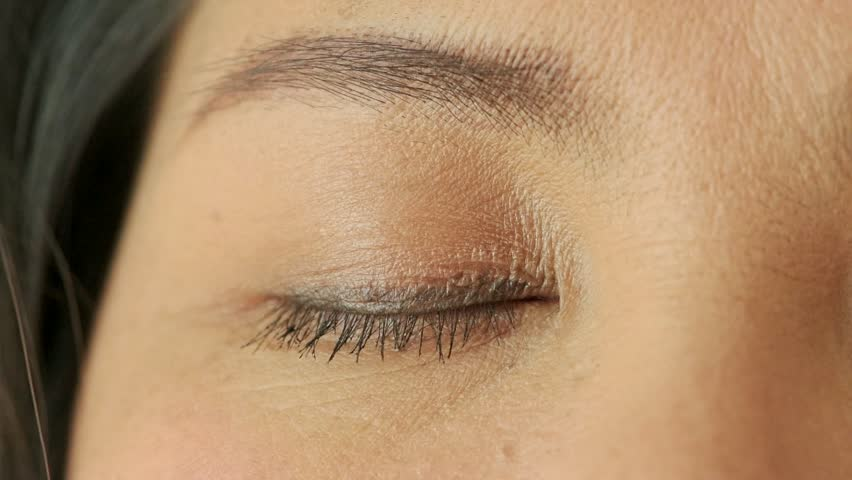 Close up of Chinese woman with her eye close.   Shutterstock HD Video #1009688252