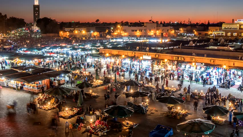 Jemaa el-Fnaa (Jamaa el Fna) square and market place in Marrakesh's medina quarter (old city), Morocco. Time lapse after sunset.