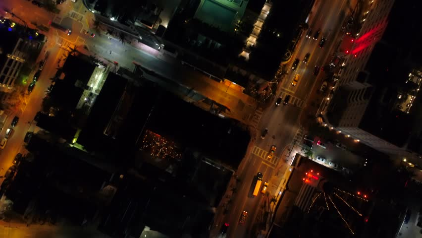 Drone flying over a city night lights Miami