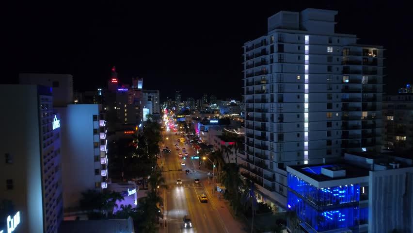 MIAMI BEACH, FL, USA - APRIL 6, 2018: Collins Avenue Miami Beach south Florida 4k drone shot