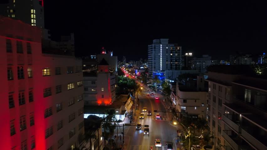 MIAMI BEACH, FL, USA - APRIL 6, 2018: City lights Collins Avenue Miami Beach aerial drone footage 4k 24p
