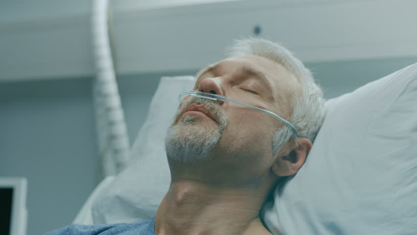 In the Hospital, Close-up Footage of Senior Patient Lying in Bed, Sleeping. Modern Hospital Geriatrics Ward. Shot on RED EPIC-W 8K Helium Cinema Camera.