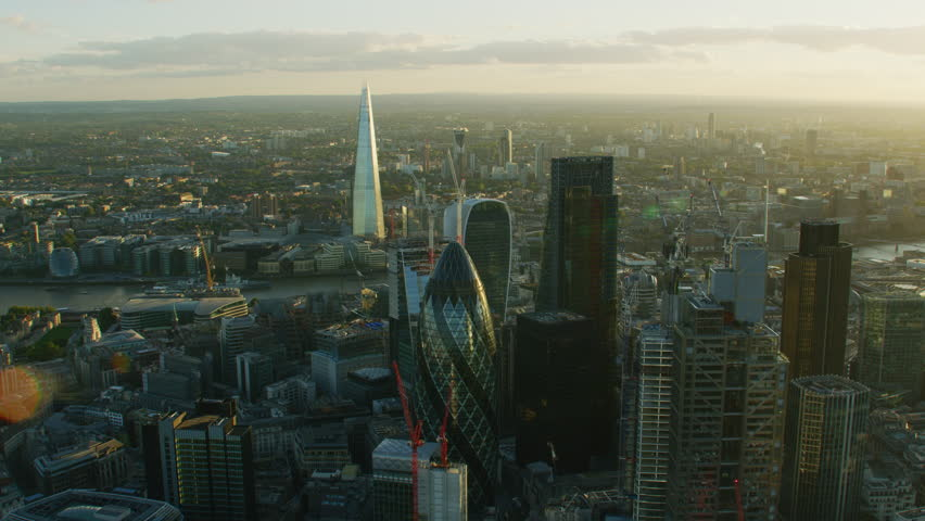 London UK - November 2017: Aerial sunset view with sun flare London cityscape financial district modern commercial skyscrapers Gherkin Shard England United Kingdom RED WEAPON | Shutterstock HD Video #1009744853