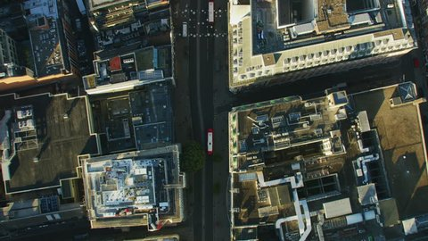 Aerial overhead view morning sunrise Oxford Street rooftops retail buildings commercial vehicles and public transport London England UK RED WEAPON