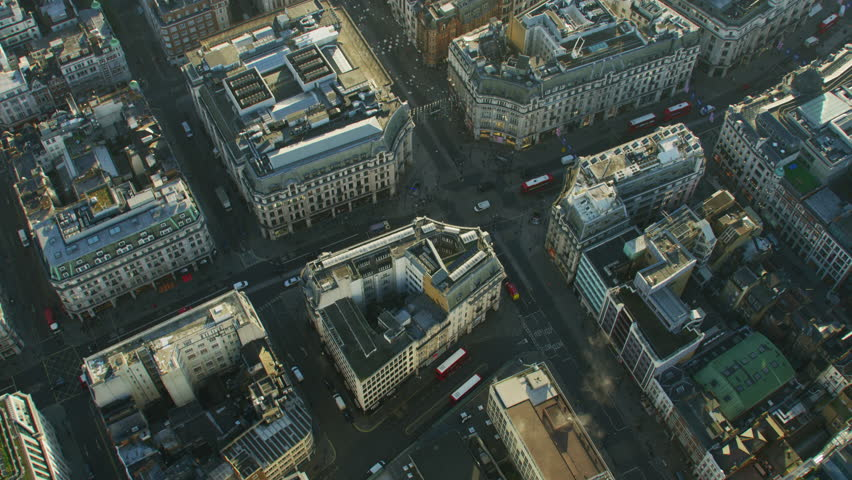 Aerial view at sunrise Oxford Circus buildings vehicle traffic and pedestrians City of Westminster London England UK RED WEAPON #1009745819
