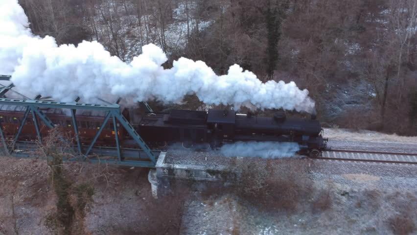 Historic steam train cross the iron bridge