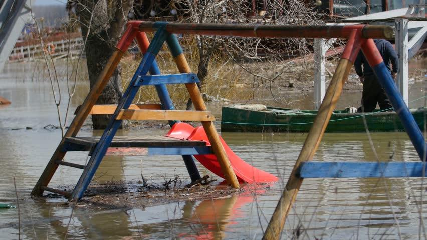 Kids Slide After Flood