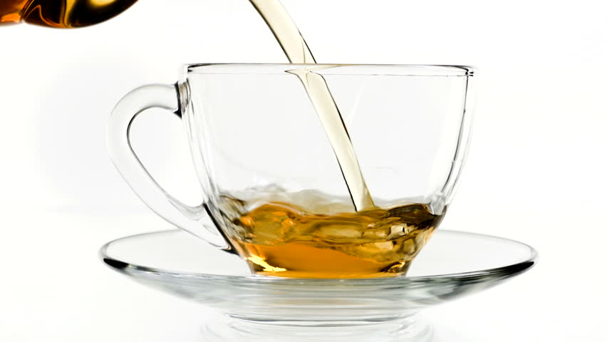 Tea pouring. Tea being poured into glass transparent tea cup. Tea time. Transparent glass teapot and teacup. Slow motion | Shutterstock HD Video #1009767644