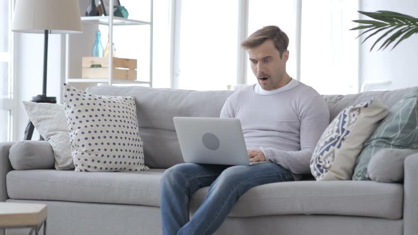 Shocked, Stunned Adult Man Working on Laptop | Shutterstock HD Video #1009770041
