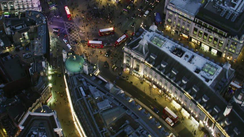 London UK - November 2017: Aerial rooftop view at night illuminated streets and buildings Piccadilly Circus pedestrians vehicle traffic London England United Kingdom RED WEAPON