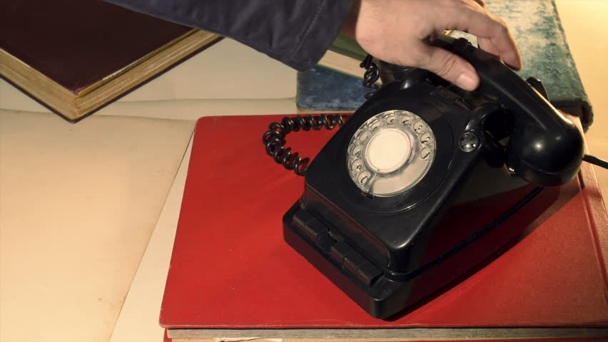 Using A Rotary Phone for making call. retro communism concept