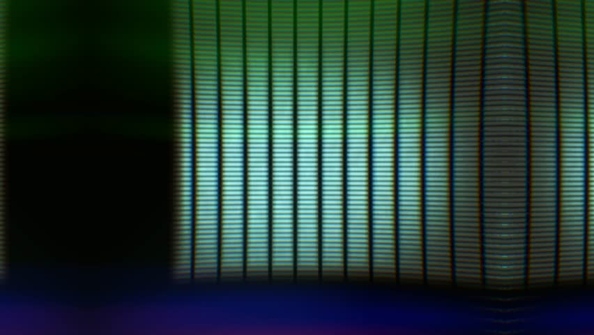 Analogue glitchy flickering colored raster lines. Glitch loop depicting technical faults or damage on retro CRT television screen for vintage technology video transitions. Loop-ready extreme close-up. | Shutterstock HD Video #1009783733