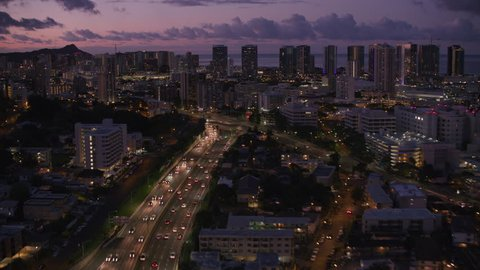 Honolulu, Oahu, Hawaii circa-2018, Aerial view of highway leading into city of Honolulu at night. Shot with Cineflex and RED Epic-W Helium.