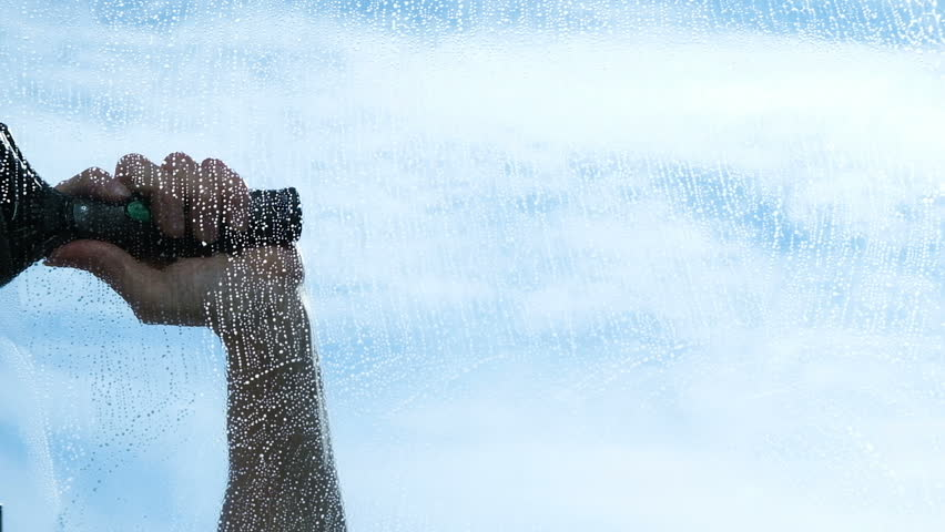 Hand cleans the wiper with a dirty window from the outside close-up, slow motion | Shutterstock HD Video #1009811636