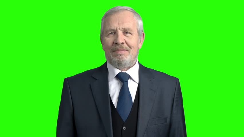 Happy elderly businessman on green background. Senior man in grey suit and tie smiling on chroma key background, slow motion. Old cheerful businessman. | Shutterstock HD Video #1009813793
